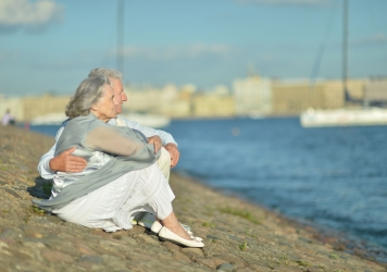 40199489 – amusing elderly couple having rest near river